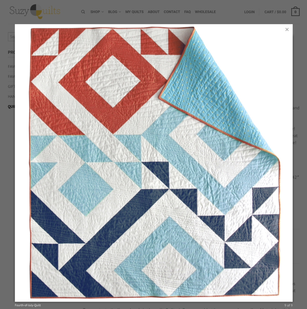 The flowing, wavy quilting is a great contrast to the angles and structure of SuzyQuilts modern baby quilt, Triangle Jitters.