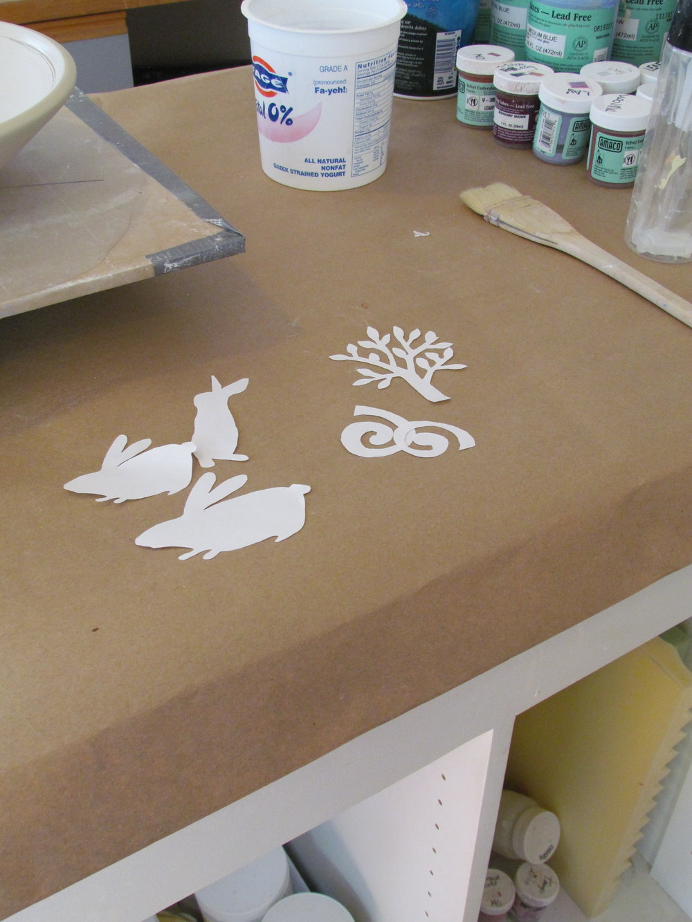 The process I have been using lately to decorate the surface of my pieces involves the use of paper stencils. I create an image and cut multiple copies of this image out of paper to create  stencils.