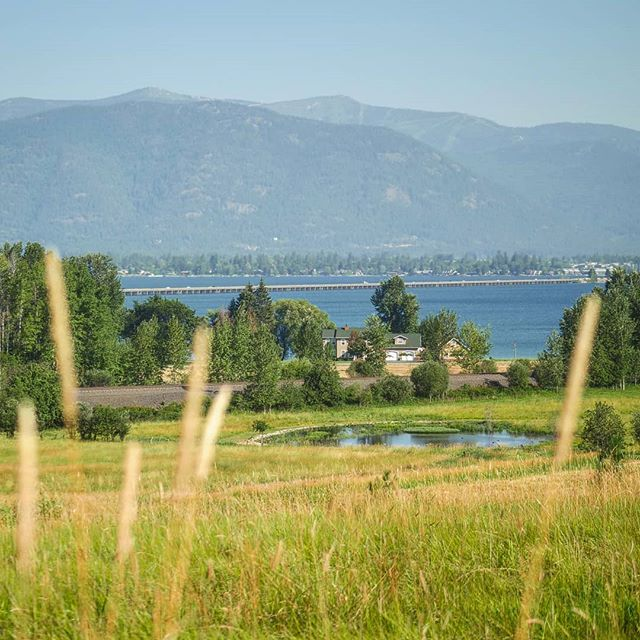 Dream home . . . . #travel #travelling #travelbug #travelgram #onlocation #onlocationshoot #filmlife #film #idaho #ponderay #pnw #pacificnorthwest #lakeside #lakeview #view #whataview #vista #dreamhome #littlehouseontheprairie #meadow