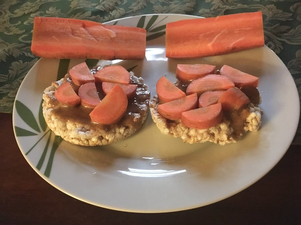 Rice cakes with almond butter and local carrots
