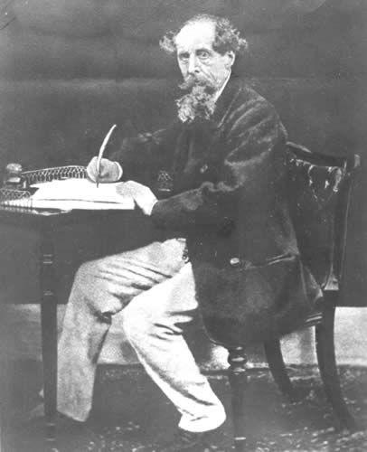 dickens-at-writing-desk-1911.jpg