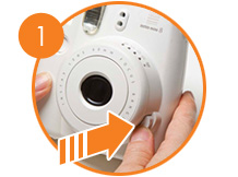 Press the button beside the lens to turn power on.