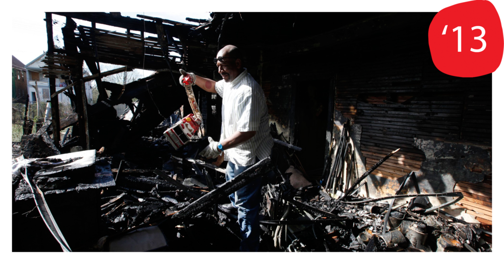 Tyree Guyton salvaging items after fire at the Obstruction of Justice House on Friday May 3, 2013 (Photo by Paul Sancya, AP)