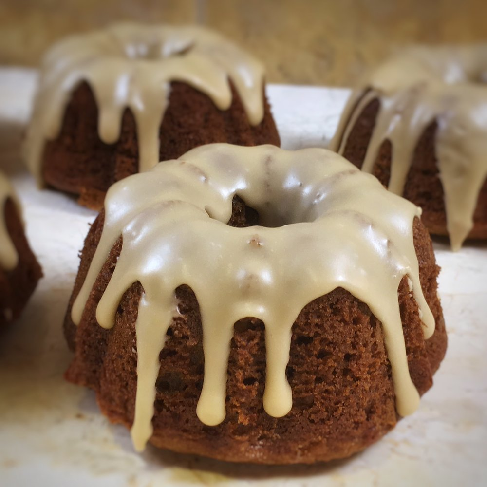 CARAMEL APPLE MINI BUNDT CAKE : Cinnamon-spiced cake topped with brown sugar caramel icing, Delicious when heated briefly. Serve with whipped cream or ice cream.