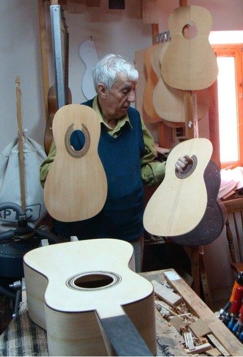 Sir  Romanillos  Holding 2 spruce tops.