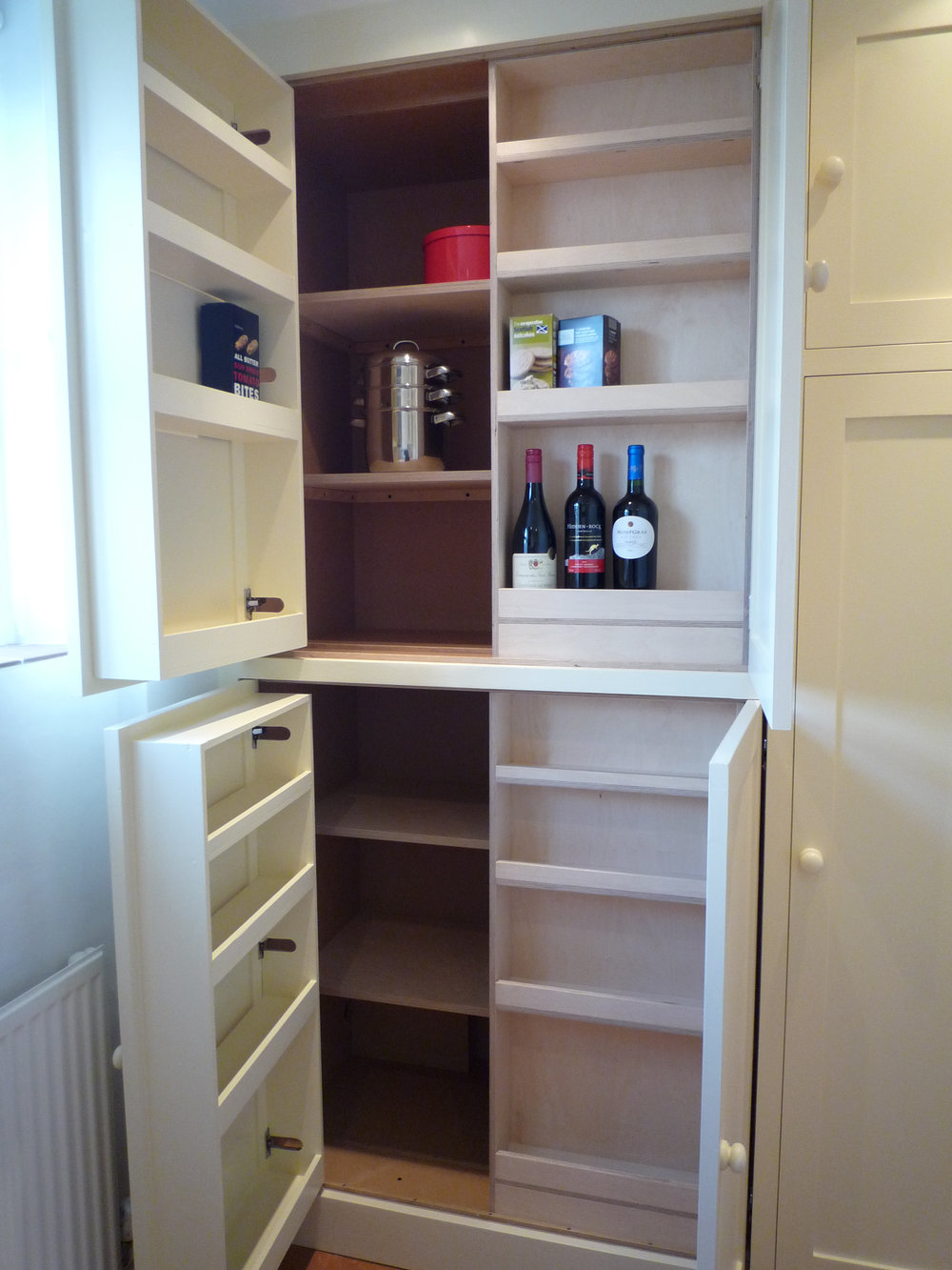 Utility room larder cupboard with door storage and sliding shelves