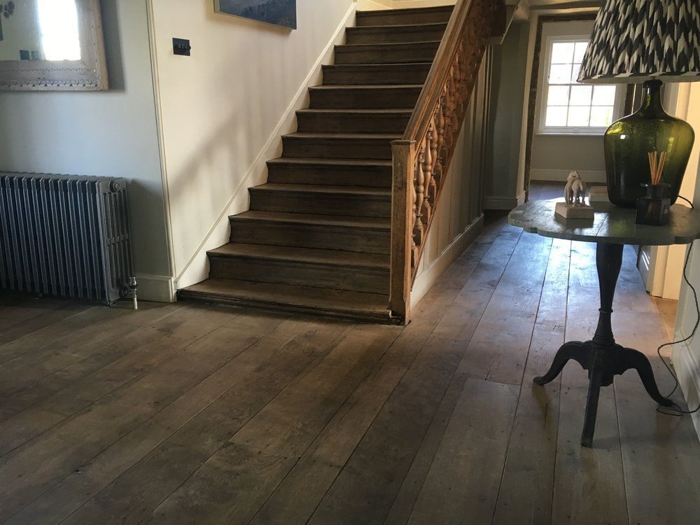New English oak floor, aged to blend with 18th century staircase.