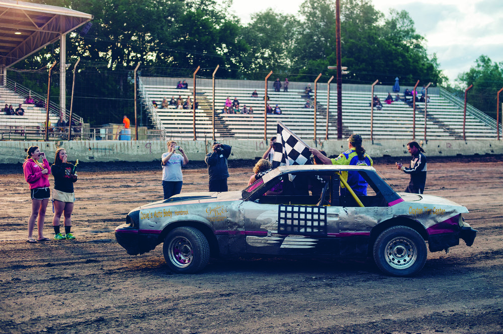 Anthony Whitaker and friends celebrate his mini stock victory at Yreka.