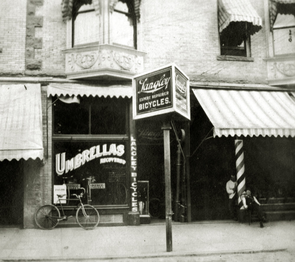 The outside of Langley's shop on 10th Street between I and J streets in Sacramento circa 1906 before he began selling motorcycles. At the time he was carrying on the family business of umbrella and bicycle repair and was the agent for Sterling bicycles.