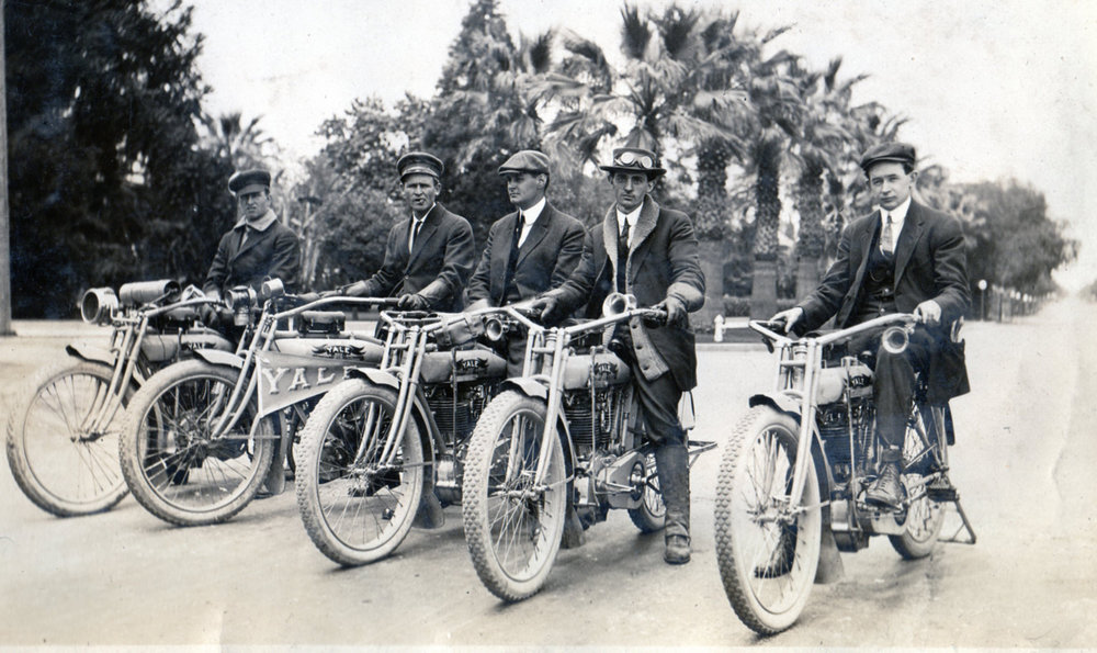 William Langley, second from the left, and a group of Yale owners pose with their new motorcycles. Langley was an agent for Excelsior, Henderson, Pierce, Jefferson, Pope and Yale. He believed the best way to sell his product was to get out with the customers and ride what he sold.