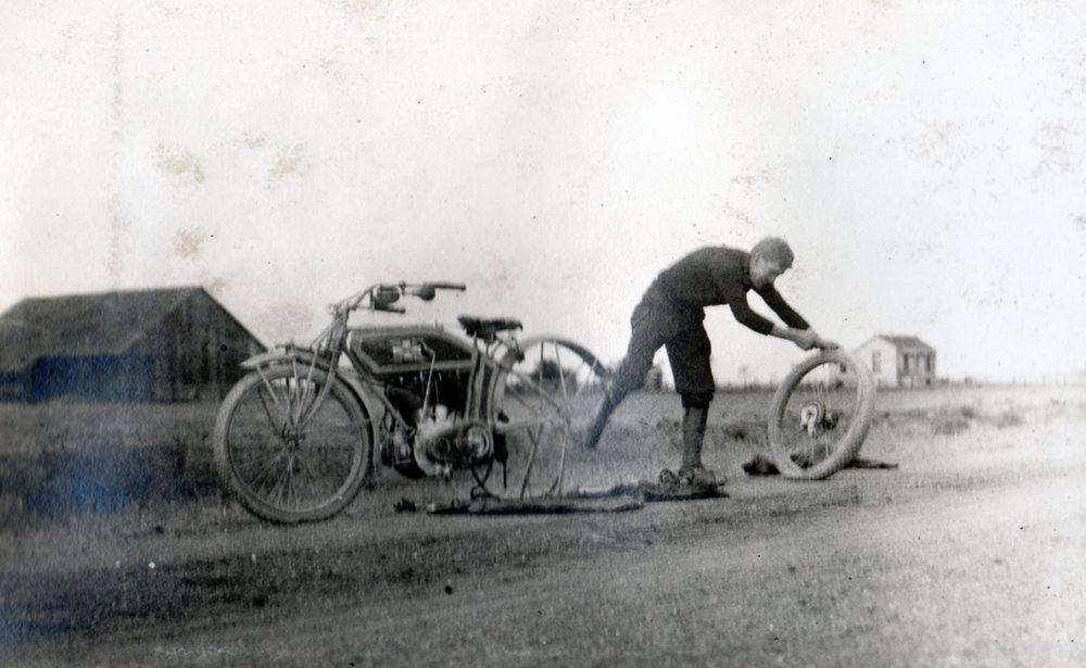 Roads were very primitive as was the equipment riders used. It was common to change or repair tires frequently on a ride.