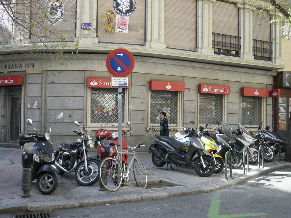 No cop in Madrid will write you a ticket for parking on the sidewalk.