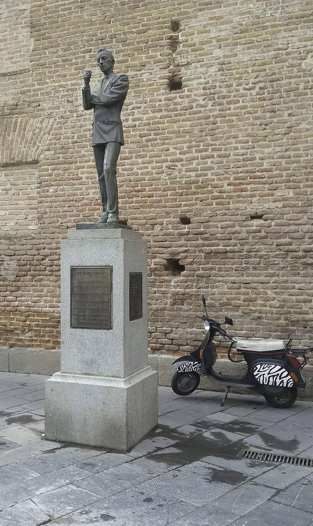 Augustine Lara contemplates Madrid as a Mod Vespa sits patiently awaiting it's owner.