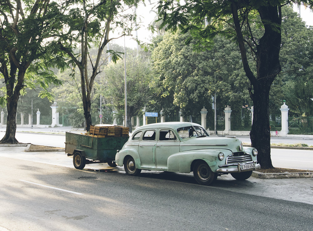 A hard-working 1940s Plymouth Special Deluxe stopped on Salvador Allende Avenue.