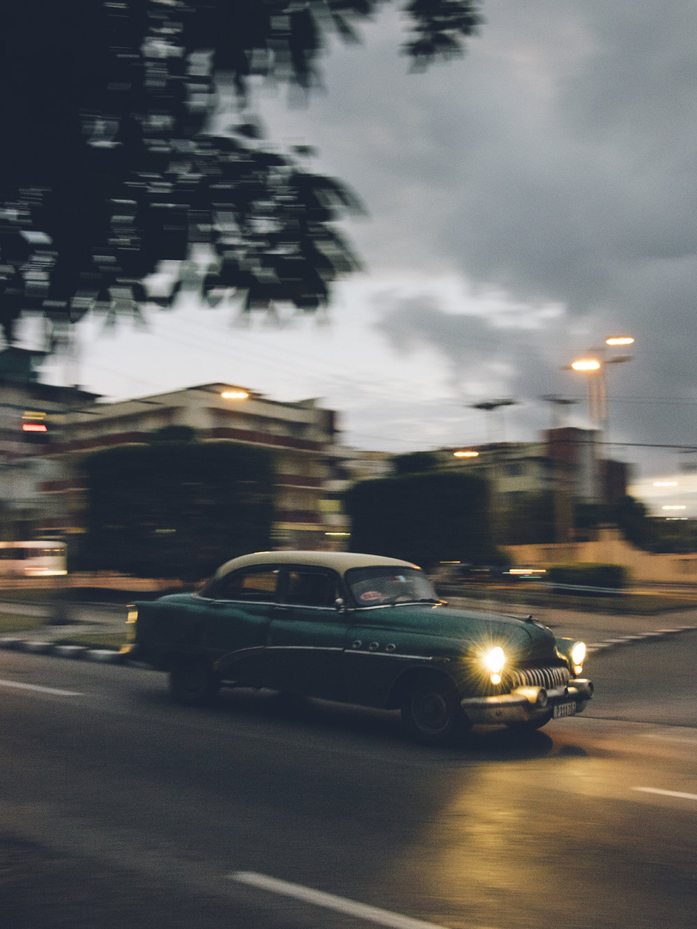 A Buick Roadmaster lumbers through the early evening.