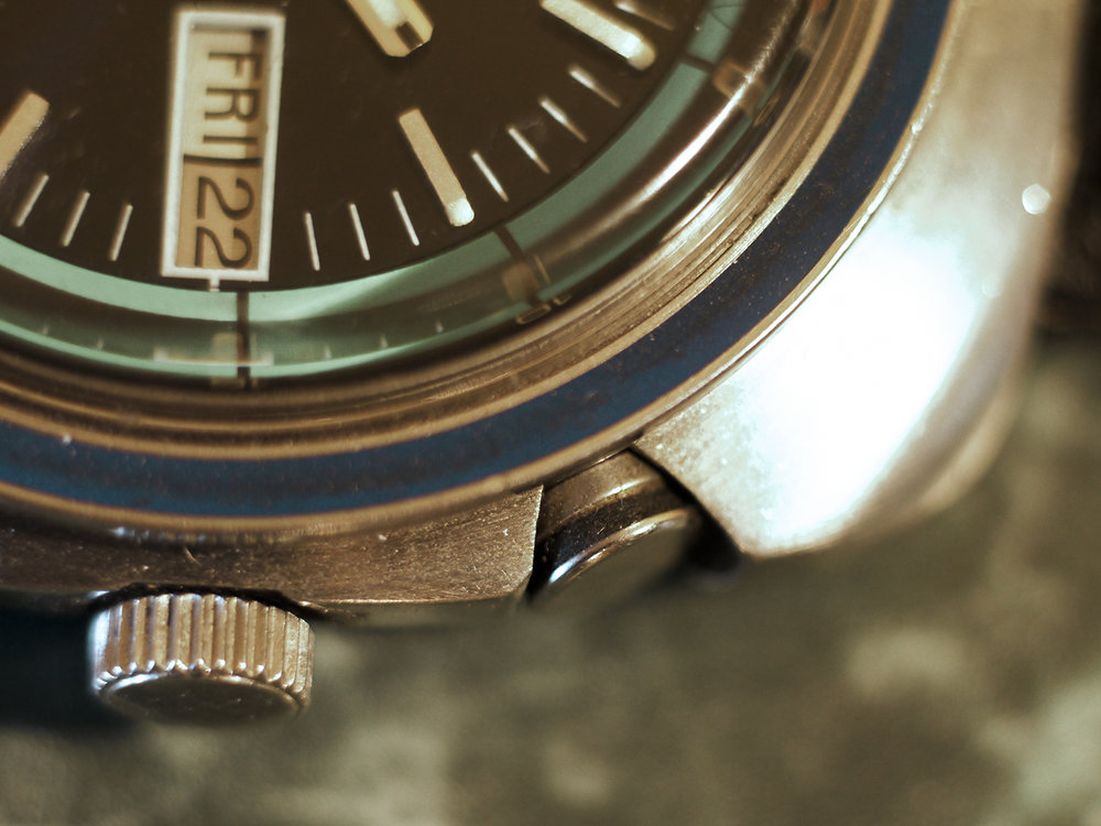 The crown wheel sets the time and also winds and sets the alarm. The watch is automatic but the spring for the alarm hammer must be wound. The upper knob turns the alarm on and off.