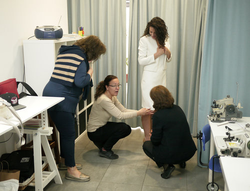 Final alterations being made to a wedding dress. Personal attention to detail is essential to success.