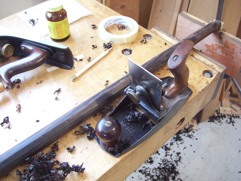 Stanley 112 scraper plane being used to smooth out flats on a cane.