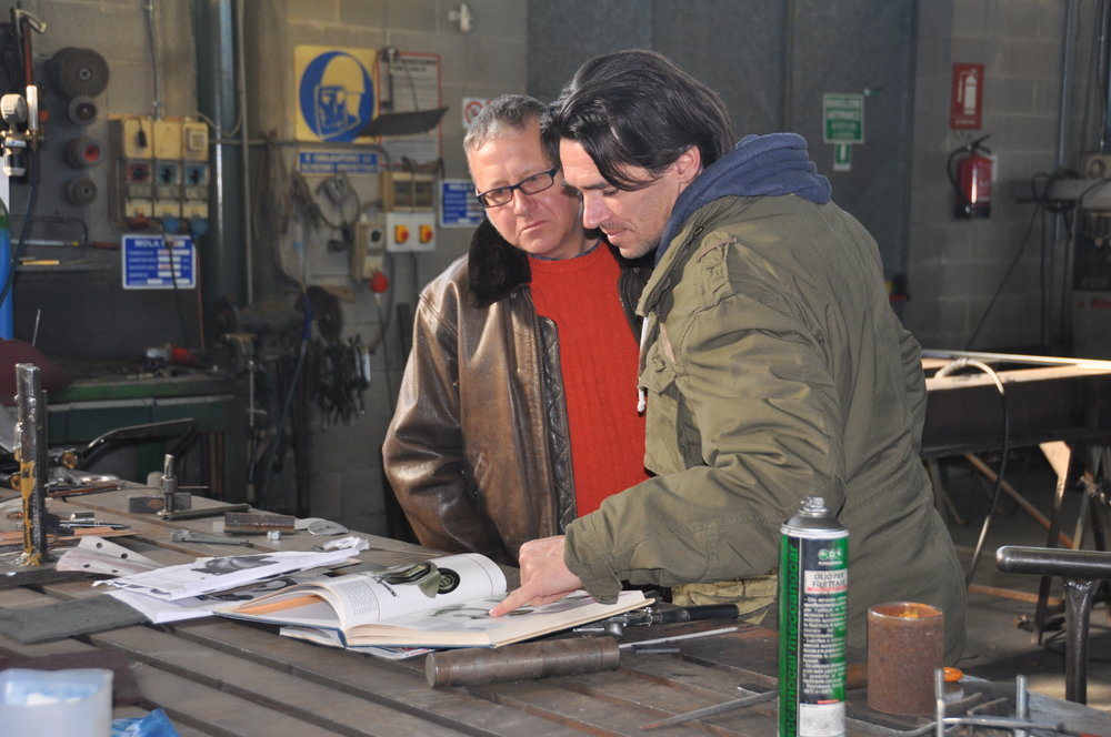Fabricator and Vespa restoration specialist Marco Quaretta (left) and Marco Fumagalli study photos of historic racing vespas during the design process of the Dafne racers. Photos: courtesy of Marco Quaretta