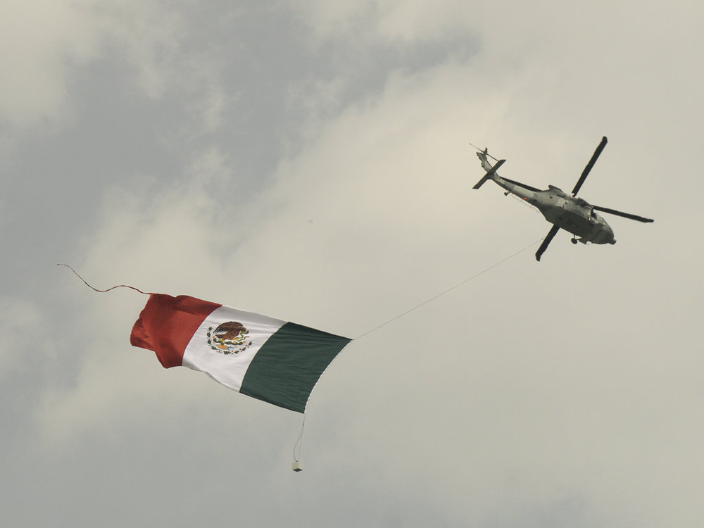 No fighter jets at this race, but a Mexican army helicopter did fly around a huge flag.
