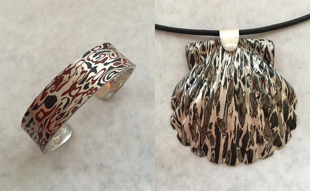 Two pieces of jewelry by Jerry Blanchard show the striking layered effect of the Mokume Gane process.