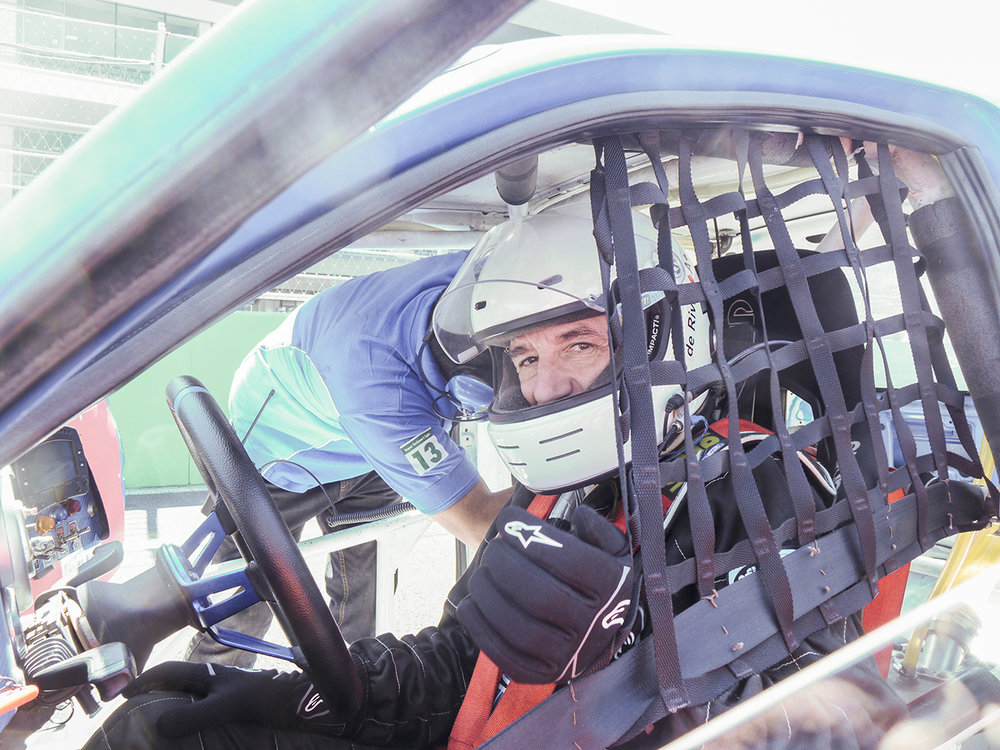 Jon Jon gets De Rivas strapped into the car on the grid.