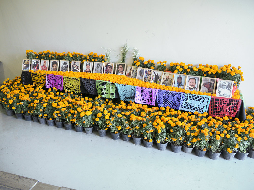 Dia de Muertos alter in the FIA pit stall commemorating racing drivers who have died.