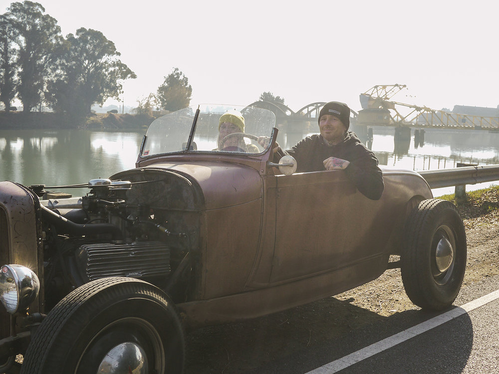 Paul Garland and his wife Rachael driving one of the cars from Bruce Woodward's collection.