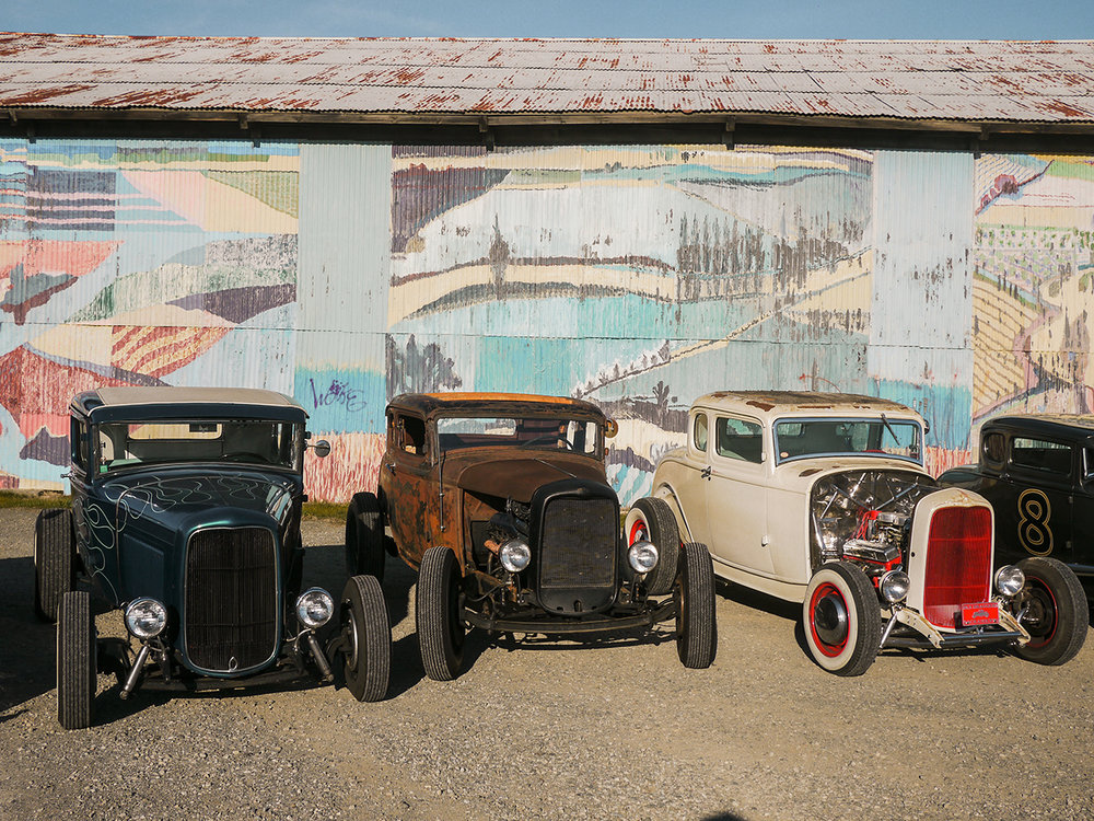 Three wicked '32 coupes. Terry Cox' singed Westergard car on the right with Johnny Kellen's rusty coupe in the center.