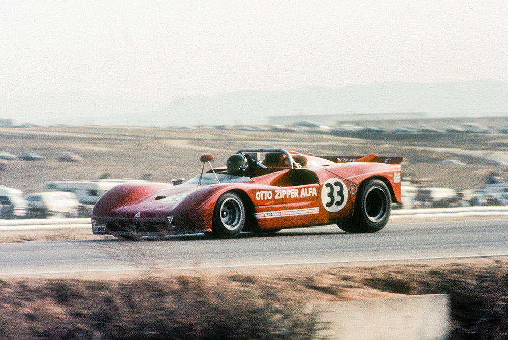 The Alfa Romeo Tipo 33/4 spider entered by Otto Zipper. Driven by American Scooter Patrick, the car which featured a much smaller engine (4.0 liter)than most of the other competitors,finished a very credible 9th place 5 laps down. Zipper was a well known Ferrari and Alfa dealer and racer whose showroom was on Wilshire and 26th in Santa Monica. Tipo 33s routinely punched above their weight thanks to being an extremely well balanced car. Primarily engineered by Carlo Chiti, they won the World Championship of Makes in 1973 and the World Sports Car Championship in 1977. The Tipo 33/4 was specially developed version to race in CanAm.