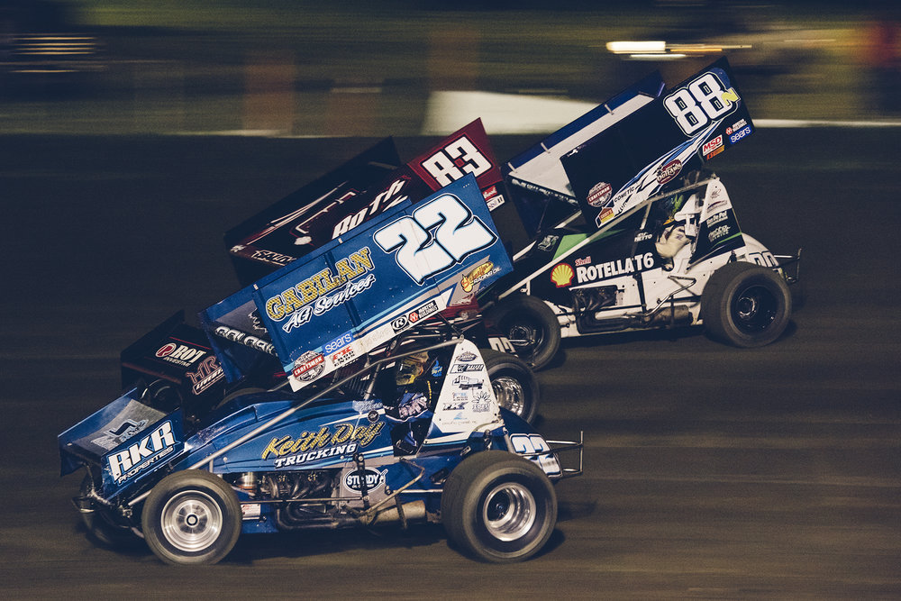 Golobic battles with Joey Saldana (83) and D.J. Netto (88n) at Ocean Speedway in Watsonville, CA, during the 2016 World of Outlaws main event.