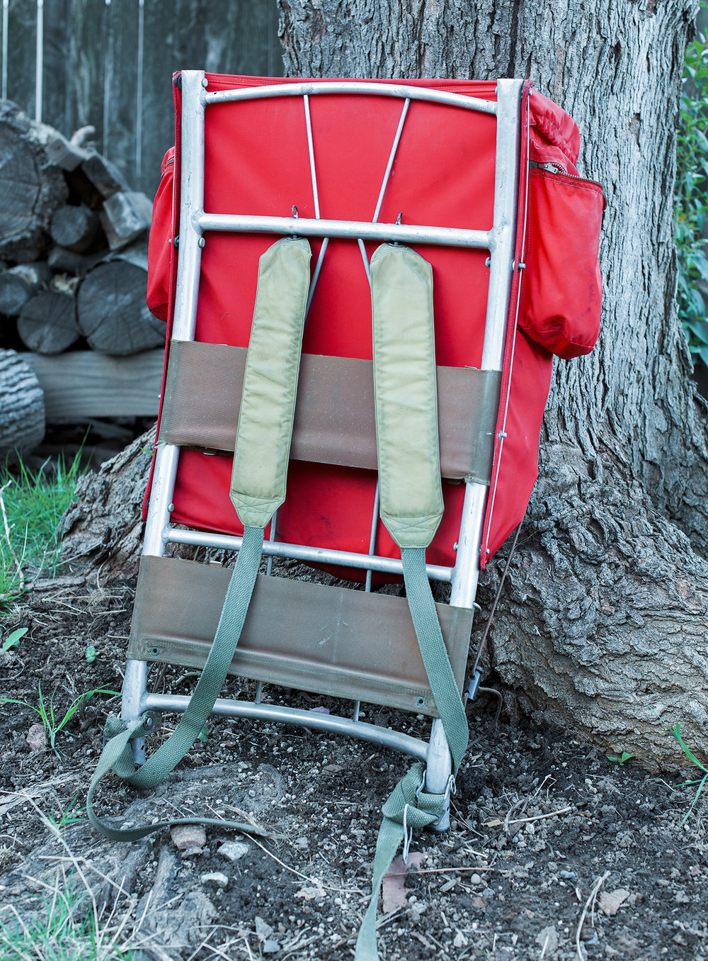 The human side of the pack. This is an early pack with the second version of the  hip strap  with the quick-release buckle. Note the padded shoulder straps, a Kelty first. Other Kelty firsts were the hip strap, aluminum frame, clevis pin method of attaching the pack bag and hold-open bar at the top of the bag. The advantage of a frame pack over an internal frame pack is that it can carry a heavier load more comfortably and lets air circulate between the pack and the packer. The main cross bars are welded to the curved uprights, creating a very stiff and strong structure.
