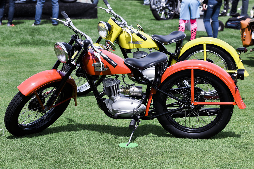 The two Harley 125cc two strokes that won first and second place in the American class. Dan Derby's yellow '54 ST165 was the top bike with his wife Sheila Hummer-Derby's '58 Hummer taking runner up. Dan did the paint on both bikes. The Hummer model was named after Sheila's father, Nebraska Harley dealer Dean Hummer
