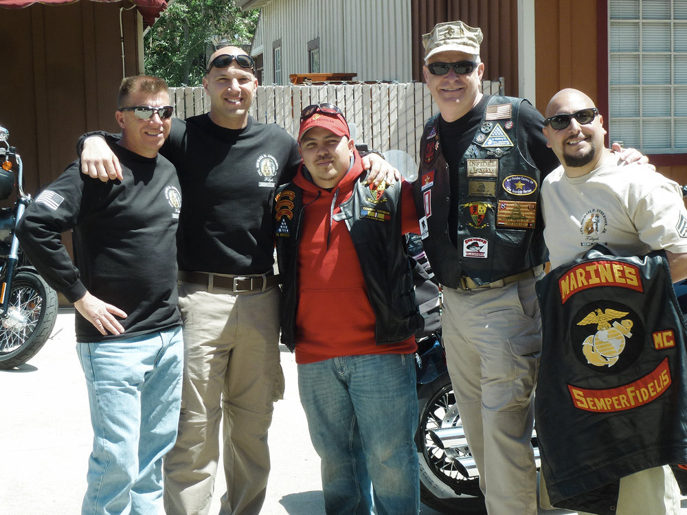 Some of the Marines who were with Corporal Mike Anderson Junior when he was killed in the battle of Falluja in 2004 posing with organizer Mike Anderson on a previous ride.