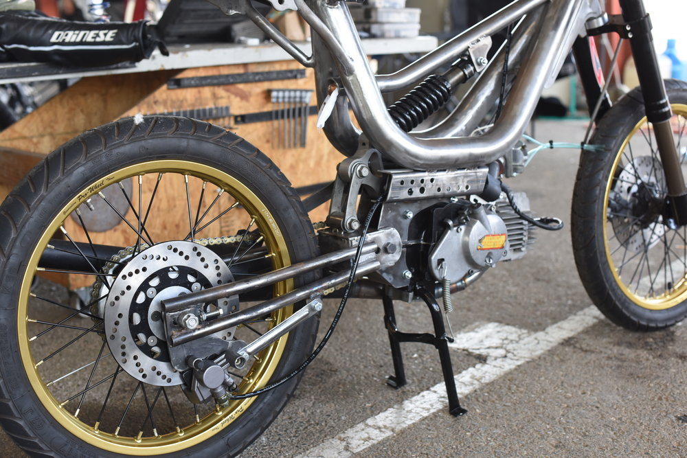 Check out the trick mono shock rear end on this Vespa. There is remarkable engineering and fabrication done in moped racing.