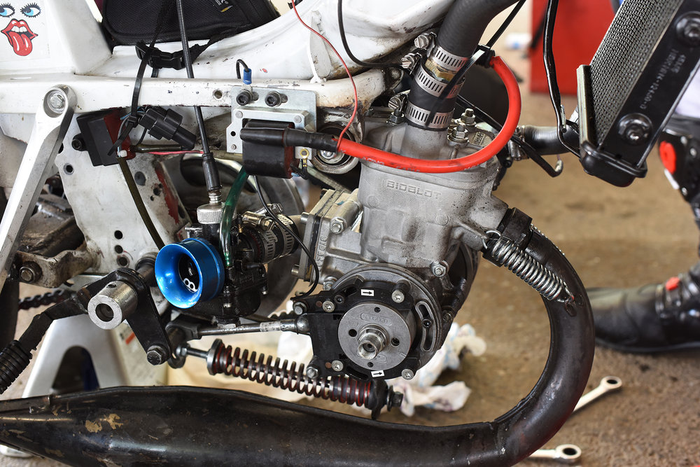 Trick Bidalot Motobecane race engine on Shane Johnson's racebike. Big reed valve case induction setup with an electronic ignition trigger driven off the crank. This is state of the art French moped race action.