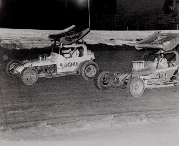 Wally Baker (100) races with Gary Patterson at West Capital Raceway. (photo courtesy: West Capital Raceway Alumni Association)