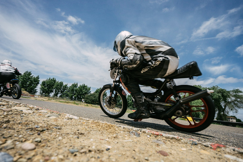 You want to keep your corner speed up on a small bike and get as low as you can on the bike. Photo Rafter