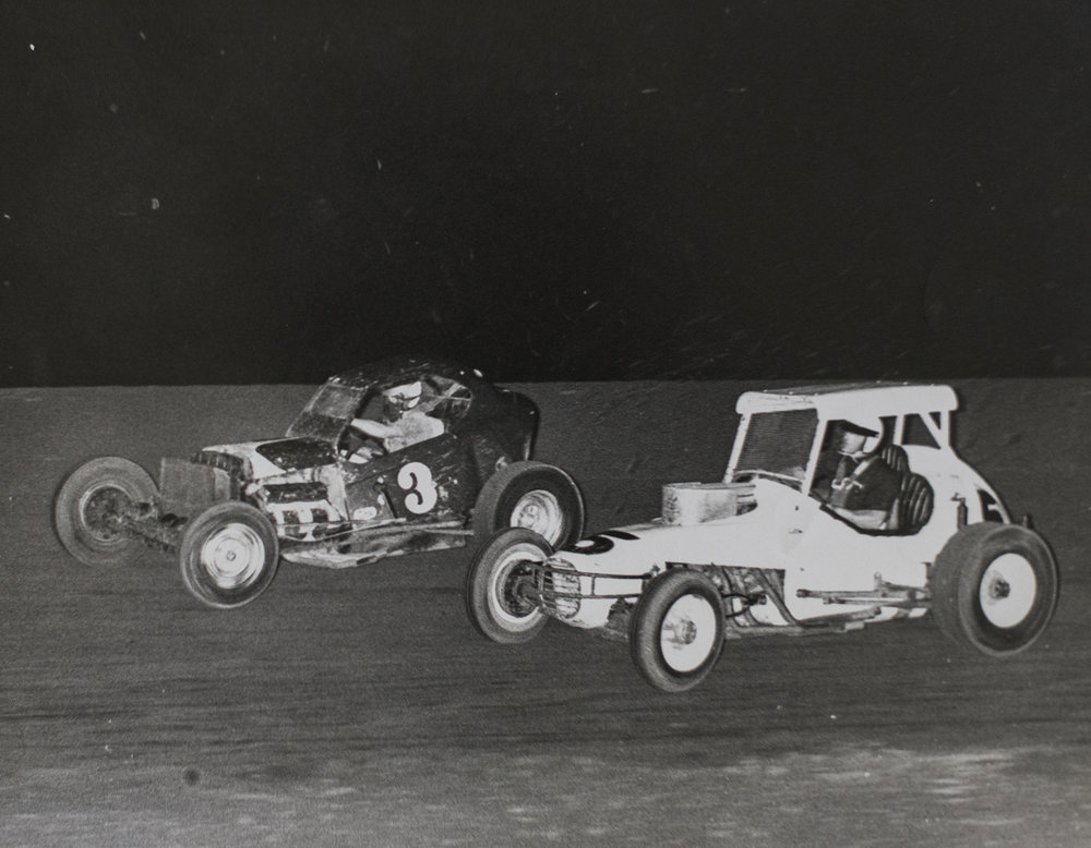 Boyd (3) racing his supermodified with a sprint car at Chico, early-'60s. (Boyd family archive)
