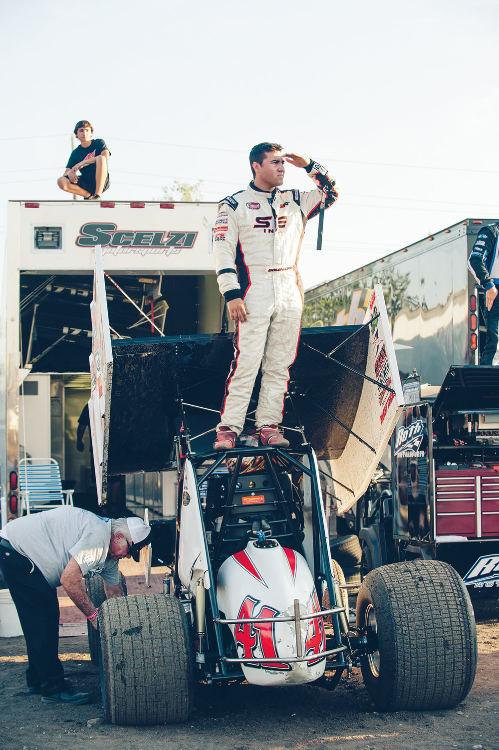 Dominic and Giovanni (on trailer) keep an eye on sprint car hot laps from the pits at Silver Dollar Speedway, 2014.