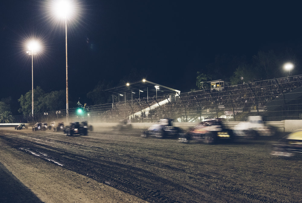 USAC sprint cars roar down the front straight at the start of the 2016 Louis Vermeil Classic at Calistoga Speedway. In operation since 1938, the dirt track is the oldest on the West Coast.