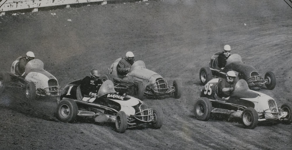 Johnny Baldwin (1) passes George Tamblyn (95) on the cushion with Tommy Morrow (4), Norm Rapp (9) and Bob O'Hara (57) following at Contra Costa Speedway, Pacheco, California, 1955. (Rapp family archive)