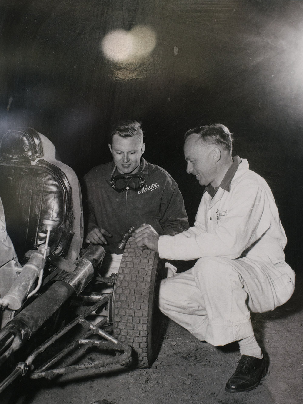 Norm Rapp (left) and his dad, Gene, look over the Kurtis midget during an indoor race at Oakland.