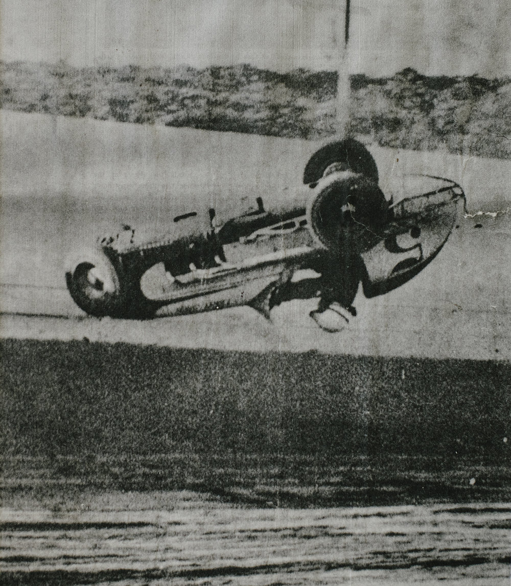 "A Wide World news wire photo of ""The Upside Down Kid,"" (as the photo was captioned), shows Rapp flipping his midget at West Capital Raceway in Sacramento in 1955. It flipped over three times. (Rapp family archive)"