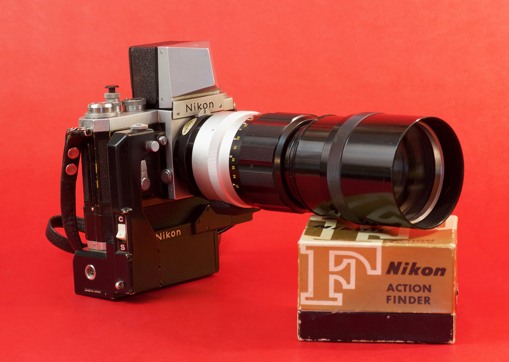 A good example of the versatility of the Nikon F system. A chrome body mounted with a Nikkor 300mm telephoto, an F-36 motordrive and the action finder. This was a popular setup with sports photographers. The modular nature of the camera made it very popular with professionals who could count on the big Nikon in any situation. The lens is in mint condition and still has its inspection sticker intact.