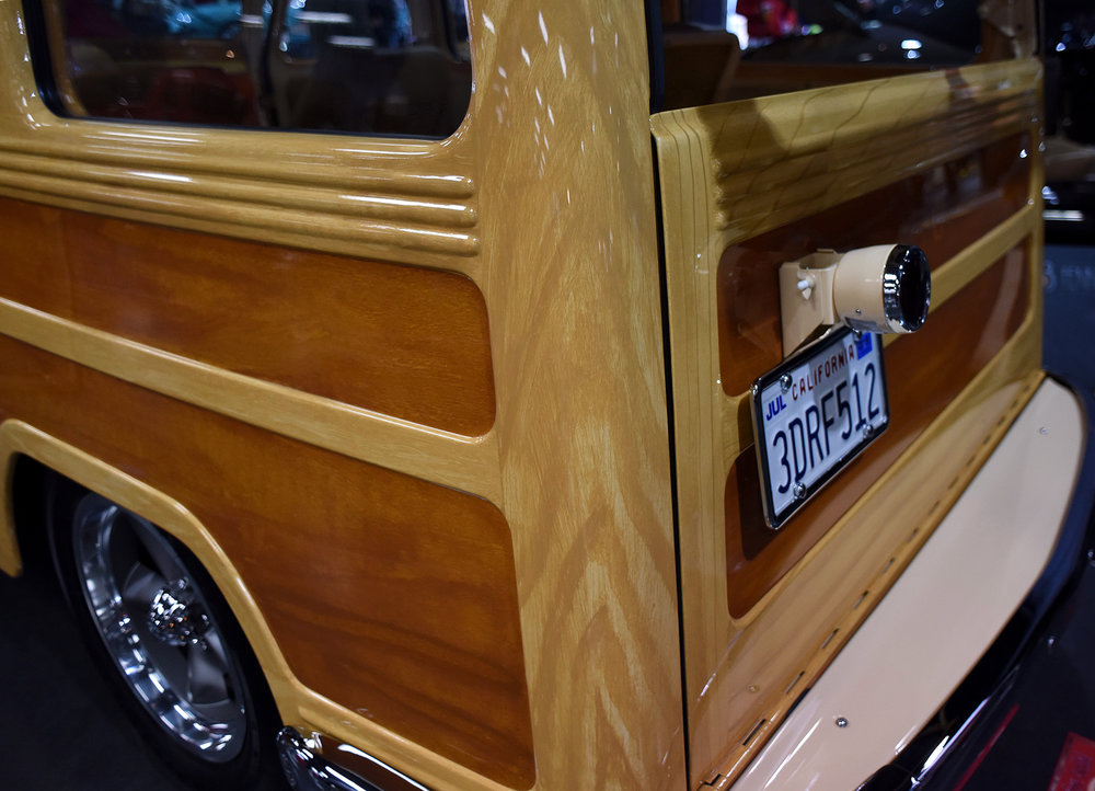 The Willys had a steel body made to look like a woody. Wilky hand painted the amazing wood grain. Looks just like Ash paneling.
