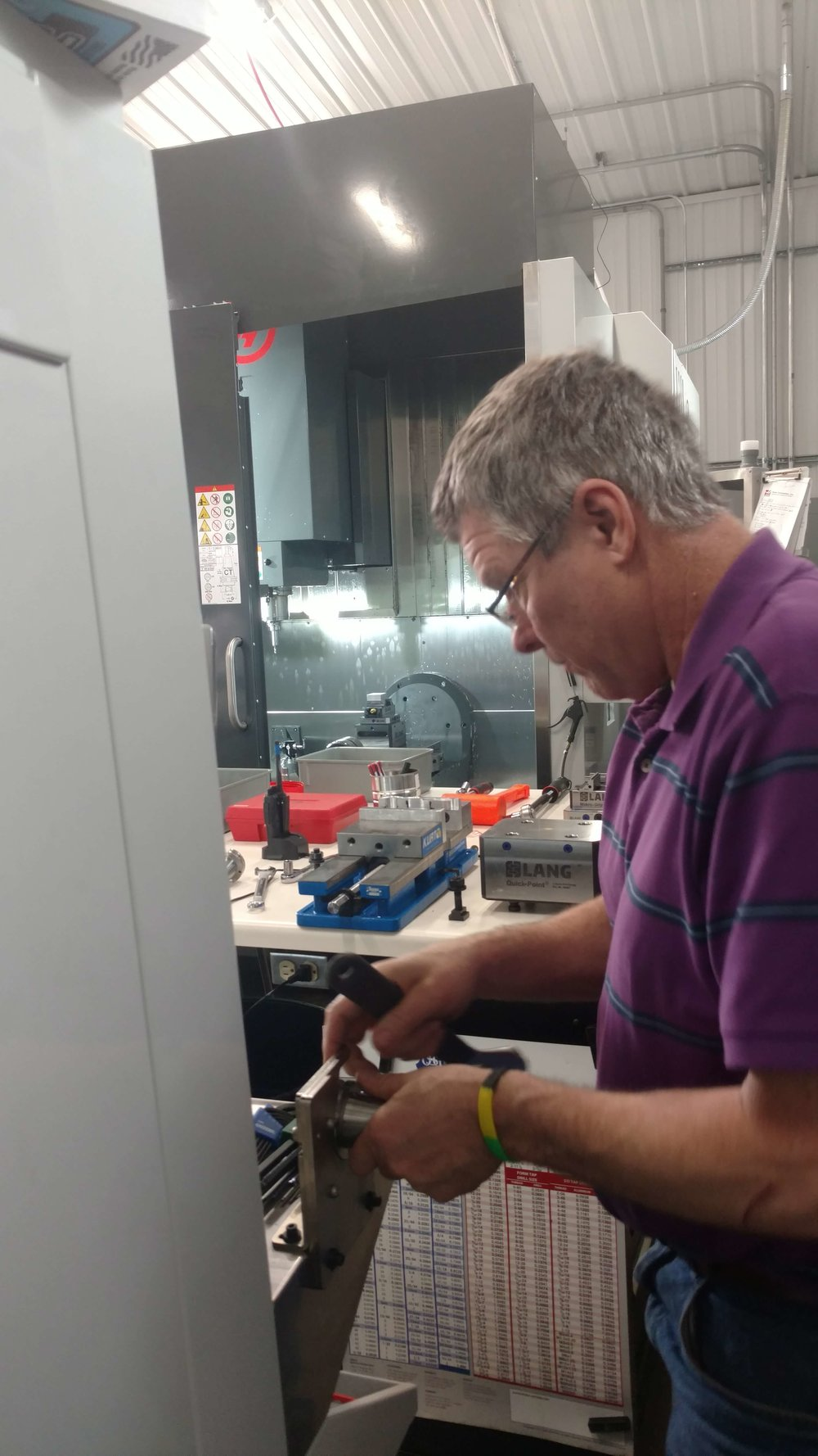 Behind owner, Ken Hastreiter, the other 19,000 pound 5 axis mill can be seen. Below, is a picture of the inside.