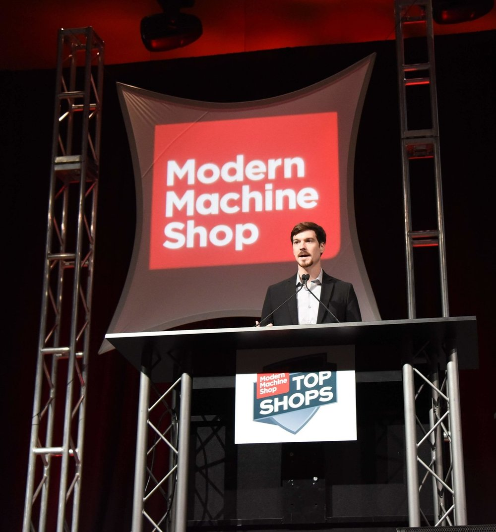 Kylan Hastreiter, Vice President, speaking at the 2018 Top Shop Conference. Hastreiter Industries was featured in the cover story of  Modern Machine Shop  magazine's 2018 September edition.