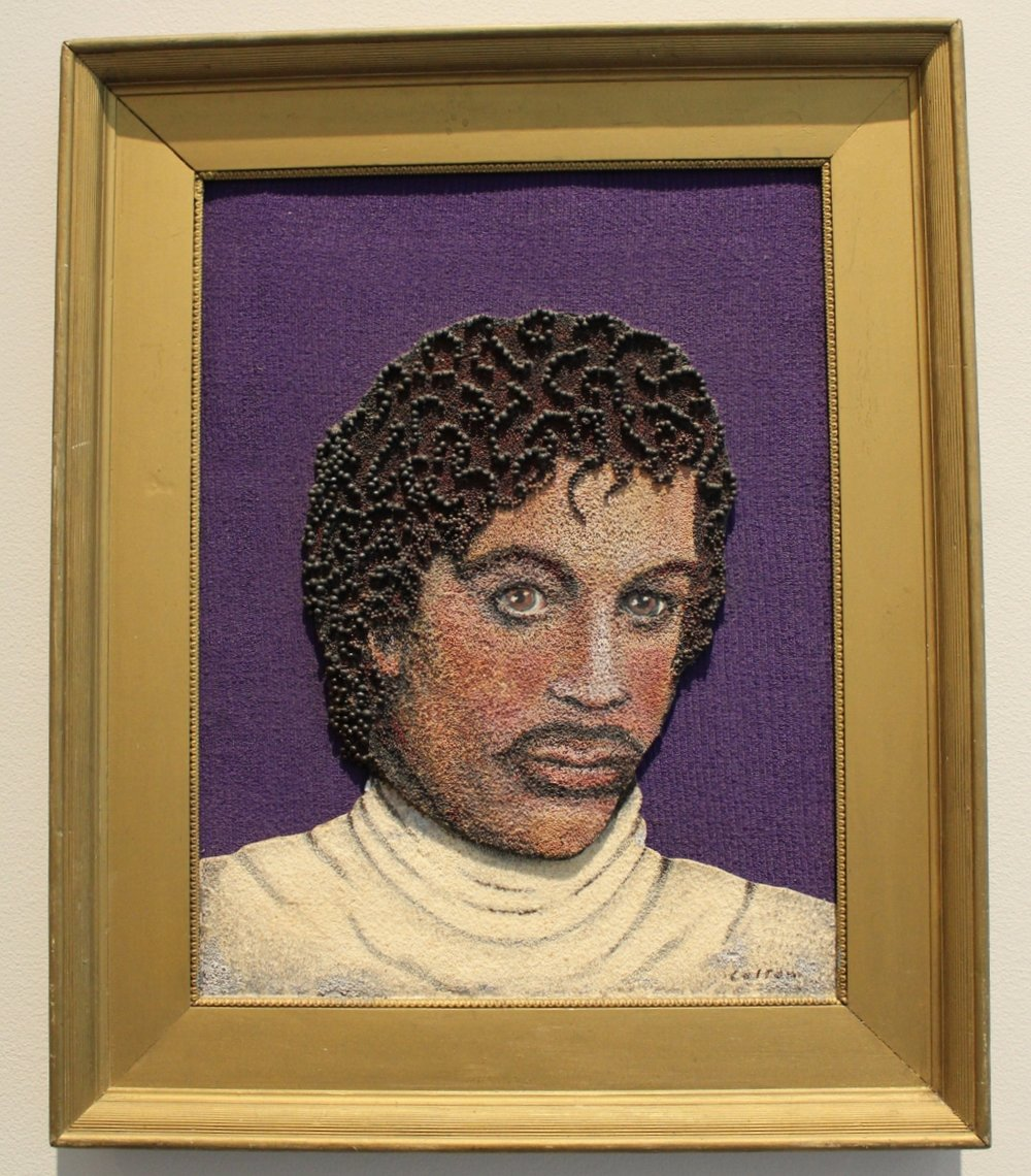 1987 portrait by Minnesotan seed artist, Lillian Colton. Materials: timothy, canola, poppy, bromegrass, and grits