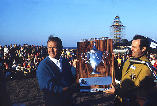 Arnie wins the first Heritage, with the unfinished lighthouse in the background.